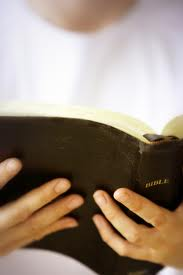 white t-shirt and Bible