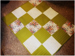 Simple quilt pattern.  Each block's rows are quilted in opposite directions.